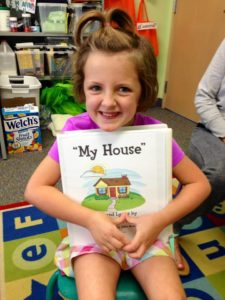 Addy with her My House book